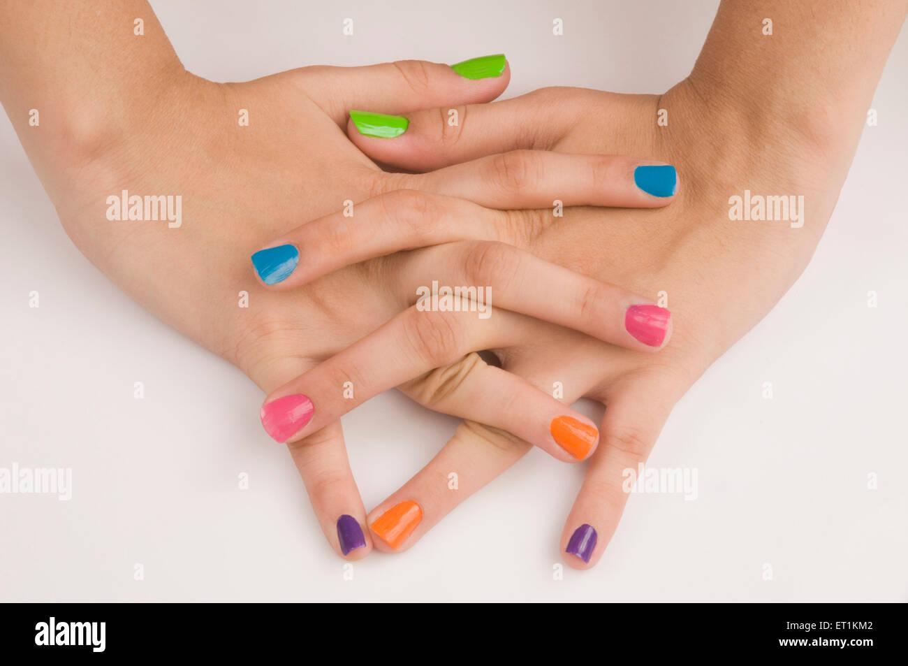 Crossed fingers of nail polish on nails Pune Maharashtra India Asia May 2011 - Stock Image