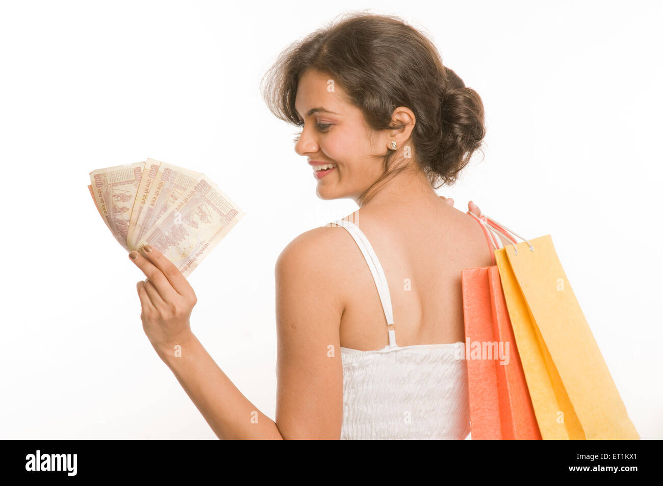 Girl with shopping bags and Five Hundred Rupee notes Pune Maharashtra India Asia MR#686 M June 2011 - Stock Image