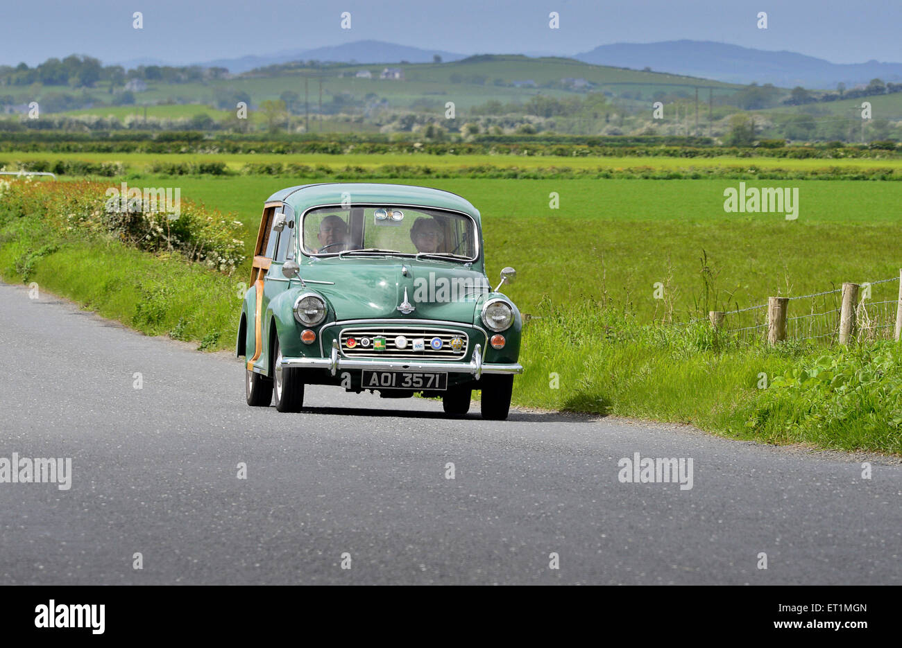 1967 Morris Minor Traveller on country road, Burnfoot, County Donegal, Ireland - Stock Image