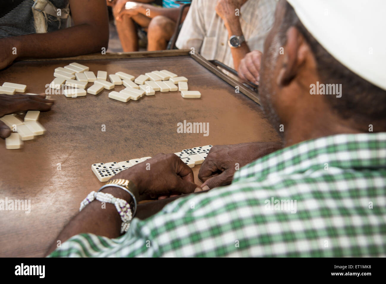 Group of old men playing dominoes - Stock Image