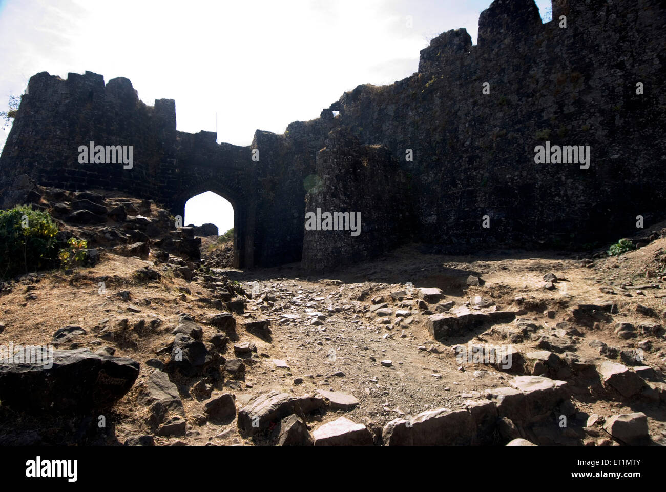 Ruins of fort Gavilgad and bastion and great main gate at Chikhaldara ; district Amravati ; Maharashtra ; India - Stock Image