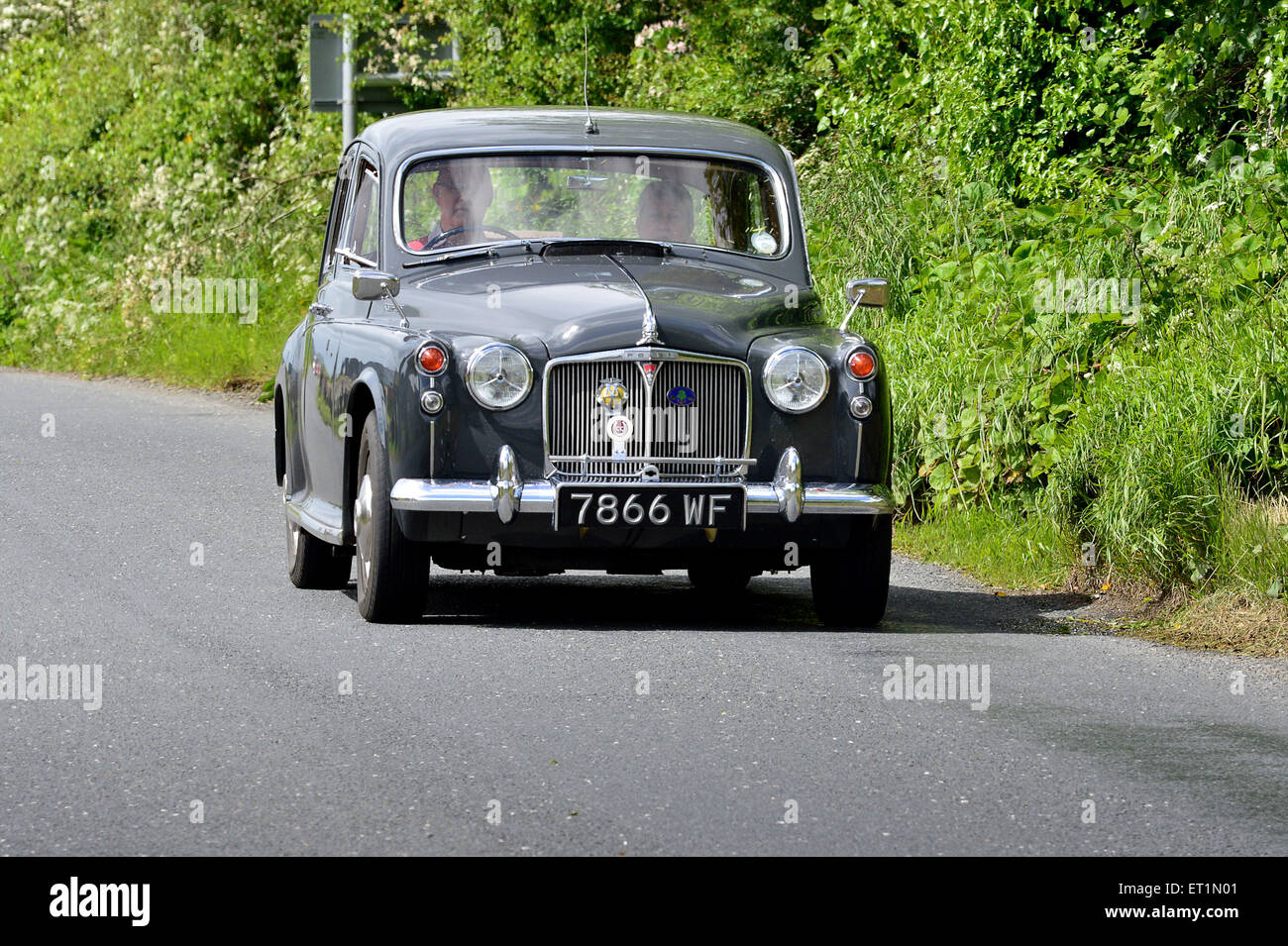 1960s Rover 100 classic saloon car on country road, Burnfoot, County Donegal, Ireland - Stock Image