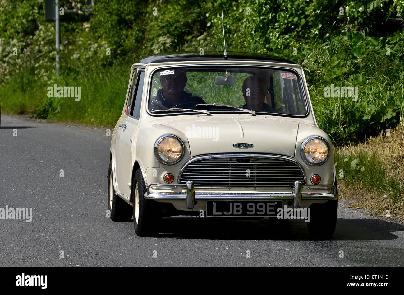 1960s Austin Mini Cooper classic car on country road, Burnfoot, County Donegal, Ireland. - Stock Image