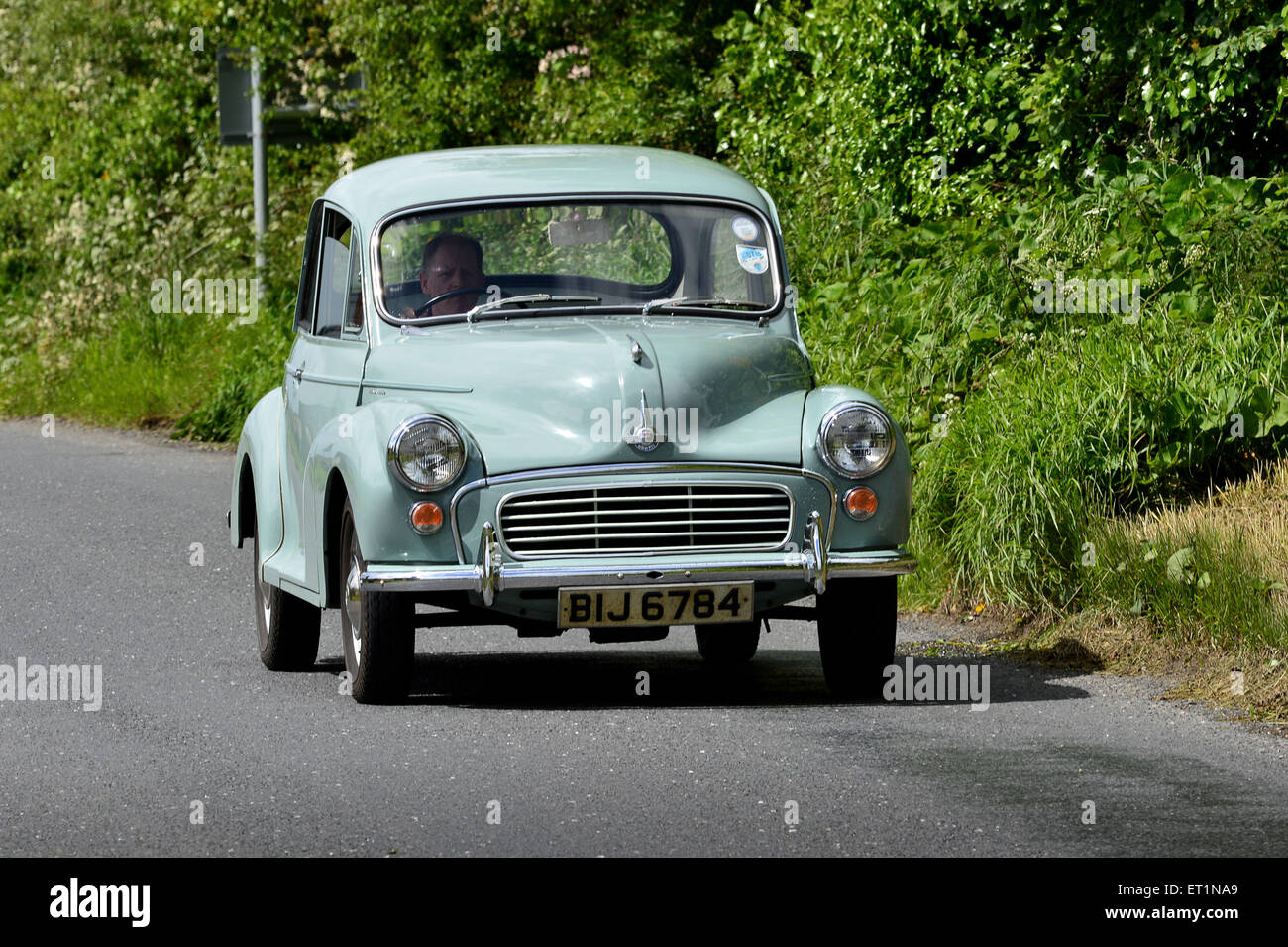 1960s Austin Morris Minor classic car on country road, Burnfoot, County Donegal, Ireland - Stock Image