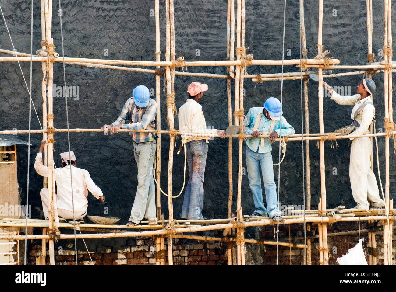 Construction workers bamboo scaffolding Bombay Mumbai  Maharashtra India - Stock Image