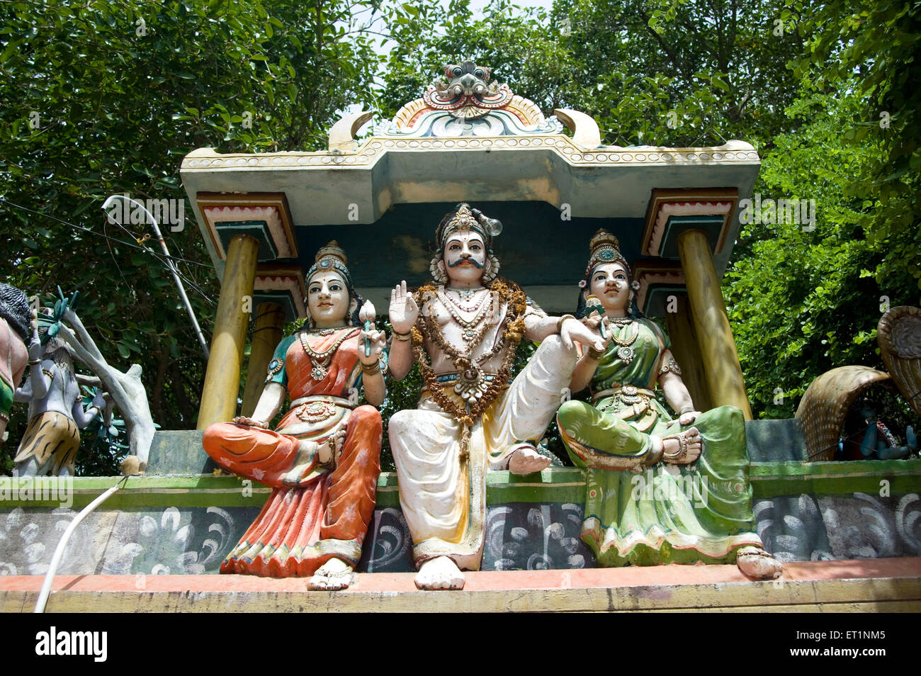 Stucco figures of god and goddesses on small temple in Tamil Nadu ; India - Stock Image