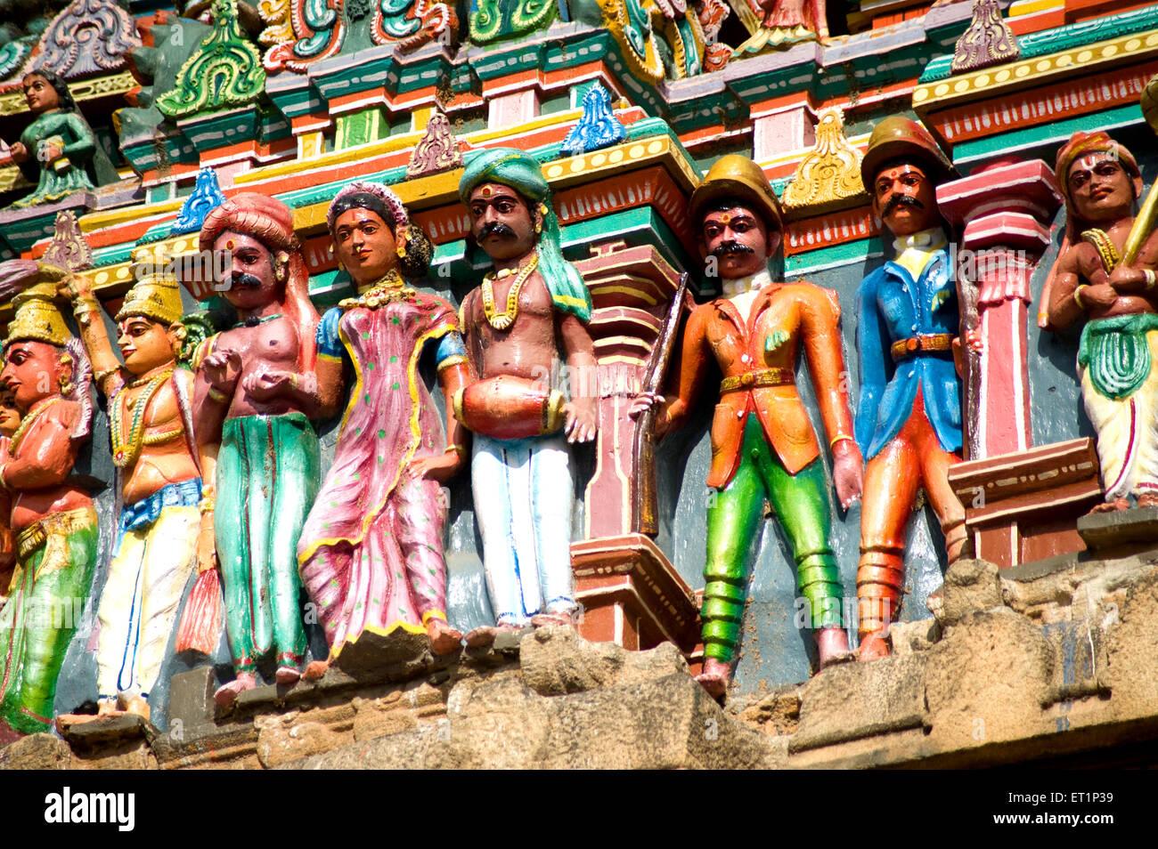 Richly painted stucco figures on gopuram of vishnu alagar kovil temple near Madurai ; Tamil Nadu India - Stock Image