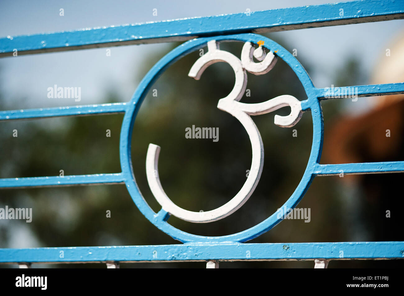 Om symbol in metal - Stock Image