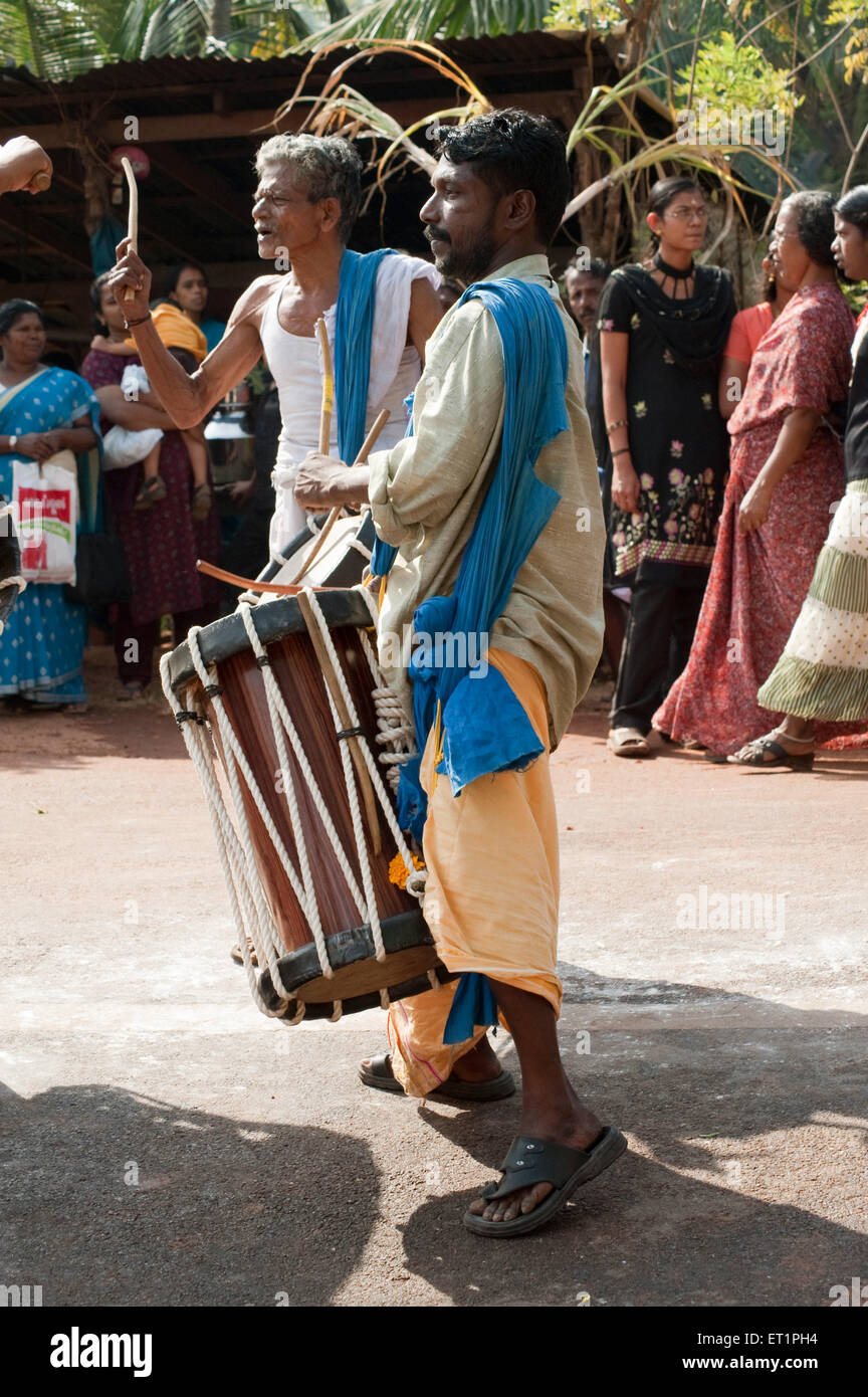 Musicians playing jendai drums ; Kerala ; India NOMR - Stock Image