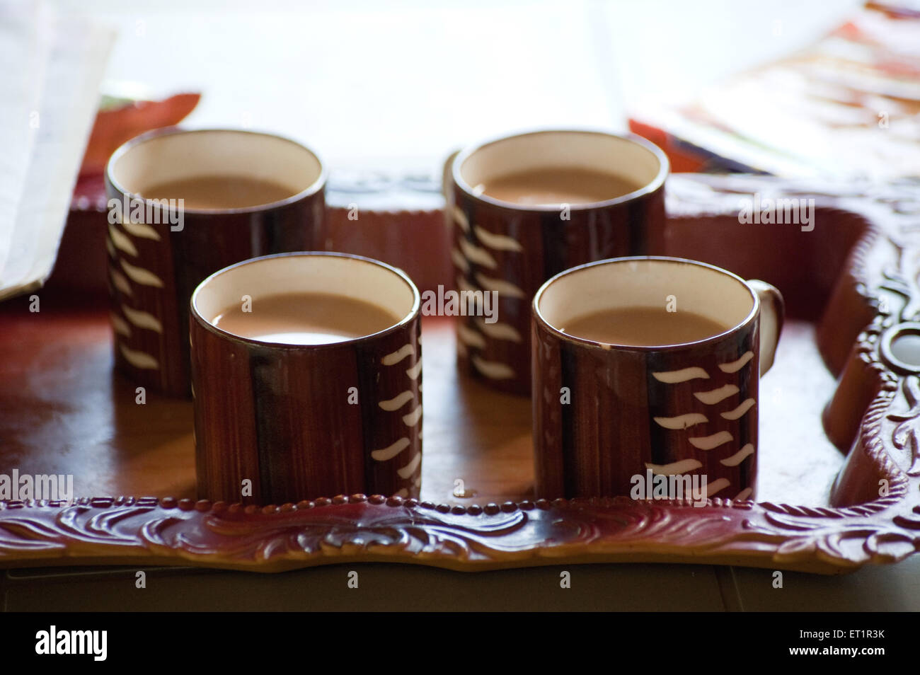 Drinks ; tea cups in plastic tray - Stock Image