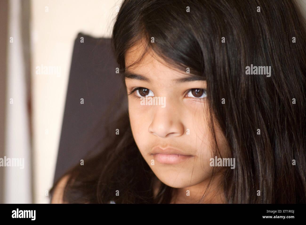 Girl in serious mood Bombay ; Mumbai ; Maharashtra ; India MR#556 - Stock Image