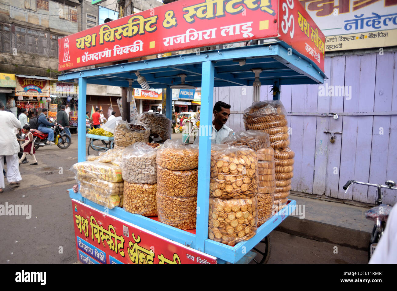 Biscuits of different sizes and shops sold on handcart at sangli Maharashtra India Asia - Stock Image