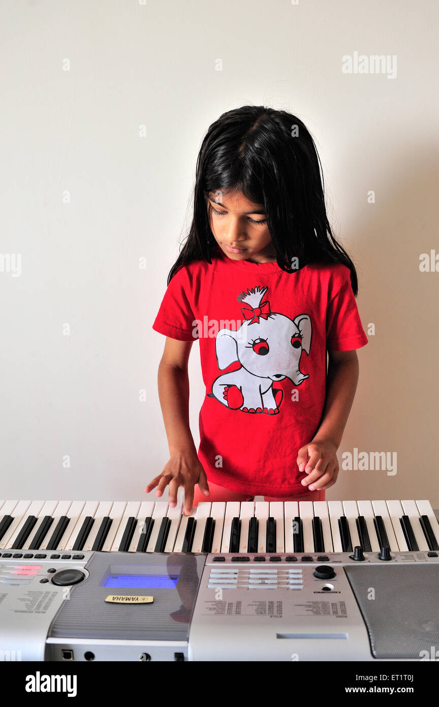 Maharashtrian girl playing synthesizer MR#556 - Stock Image