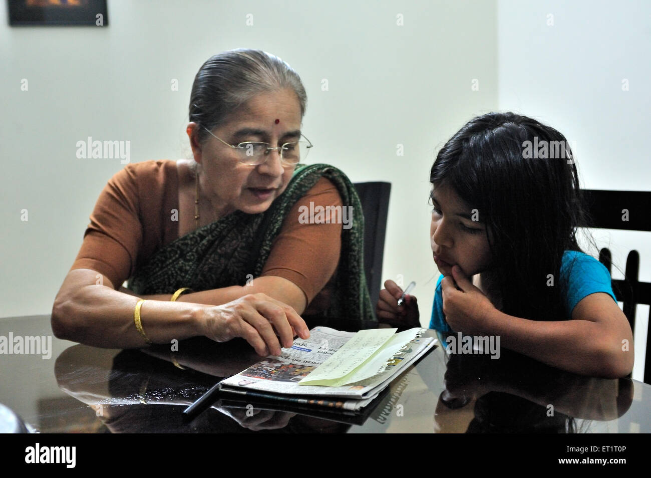 Grand mother taking study of daughter MR#556 - Stock Image