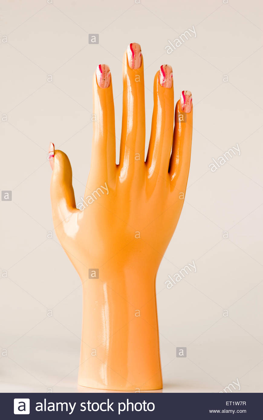 One mannequin hand showing acrylic painted design on nails against ...