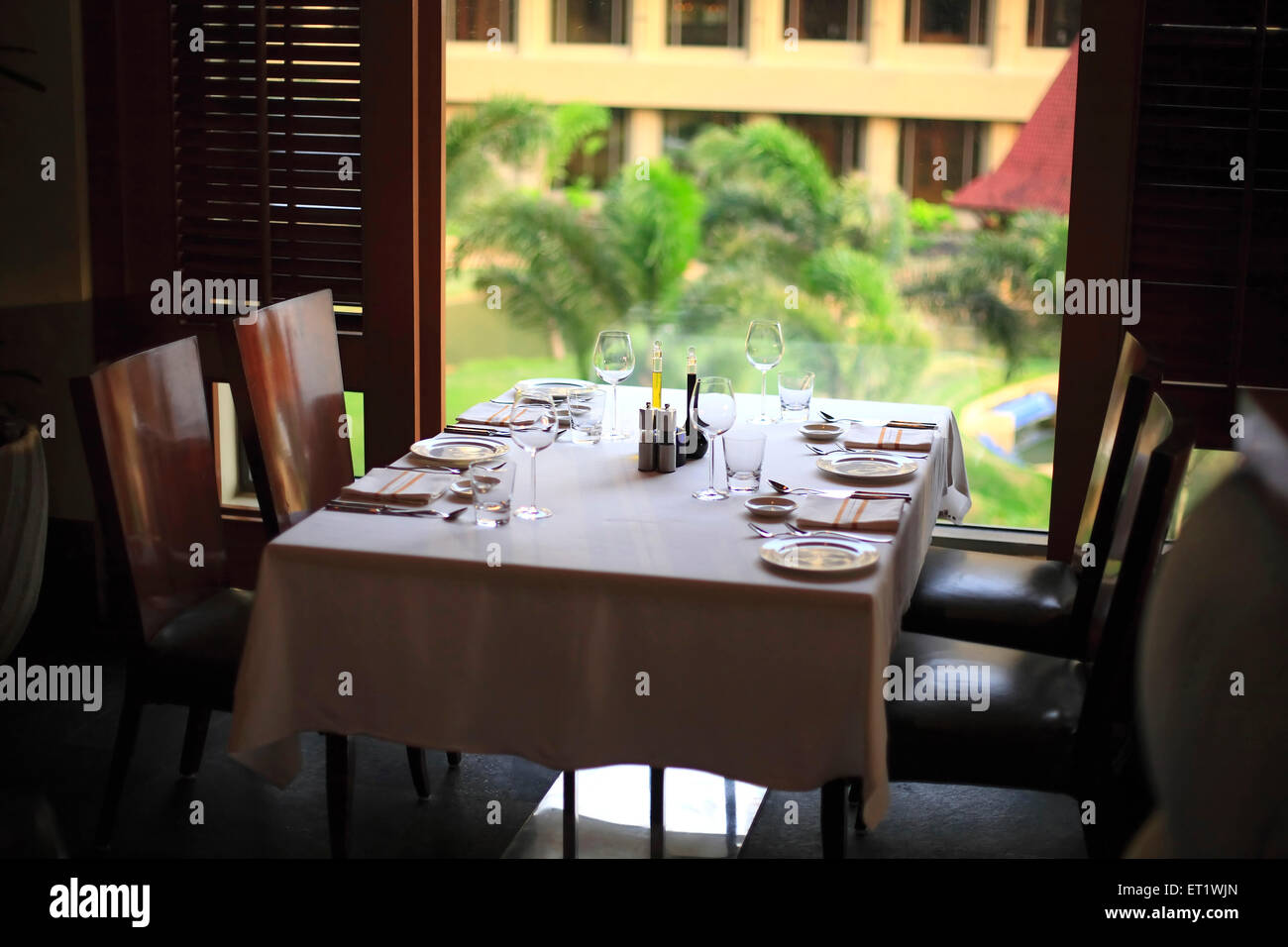Dining table in hotel with cutlery ; Bombay Mumbai ; Maharashtra ; India - Stock Image