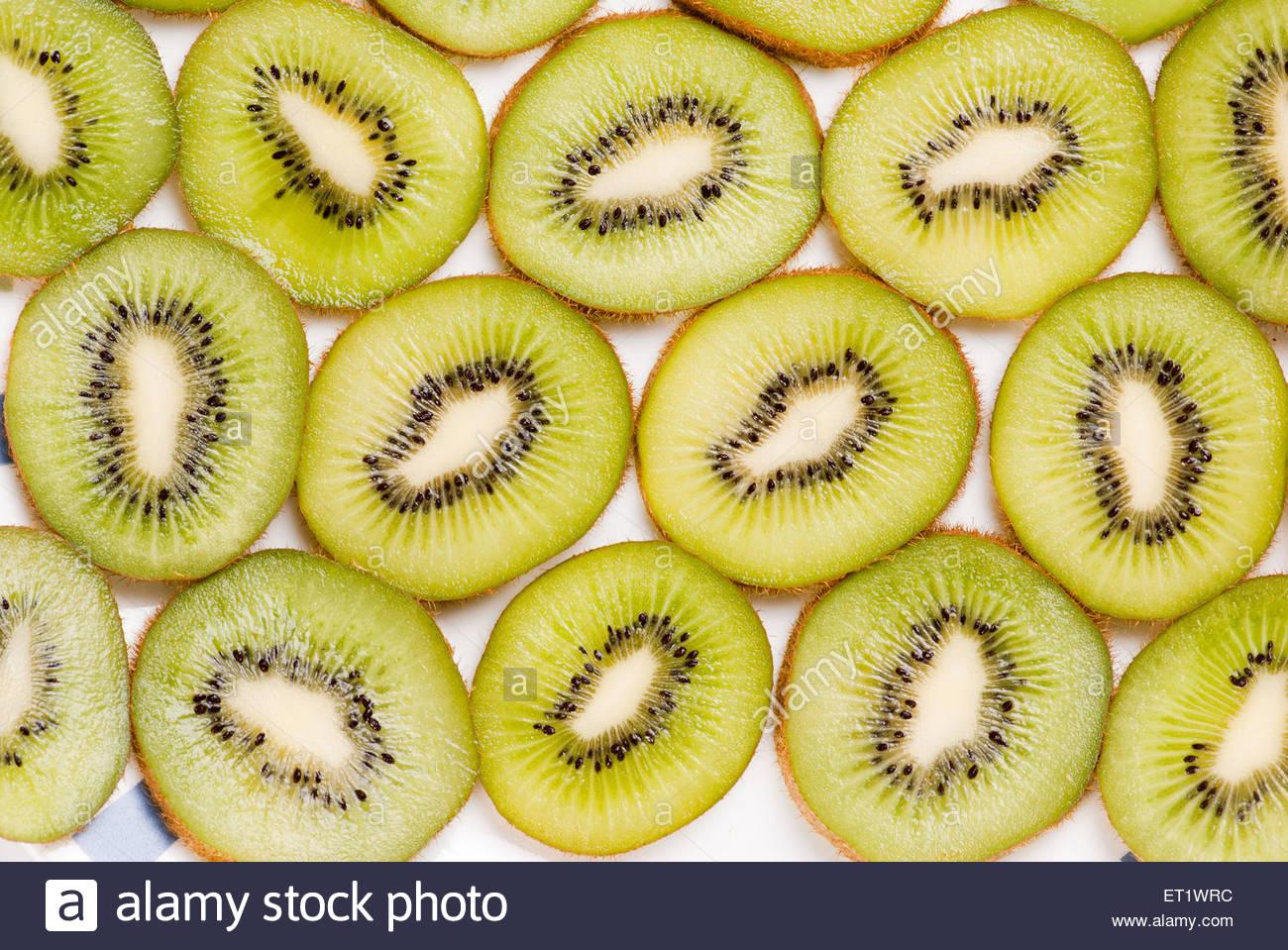 sliced full frame kiwi fruit - Stock Image