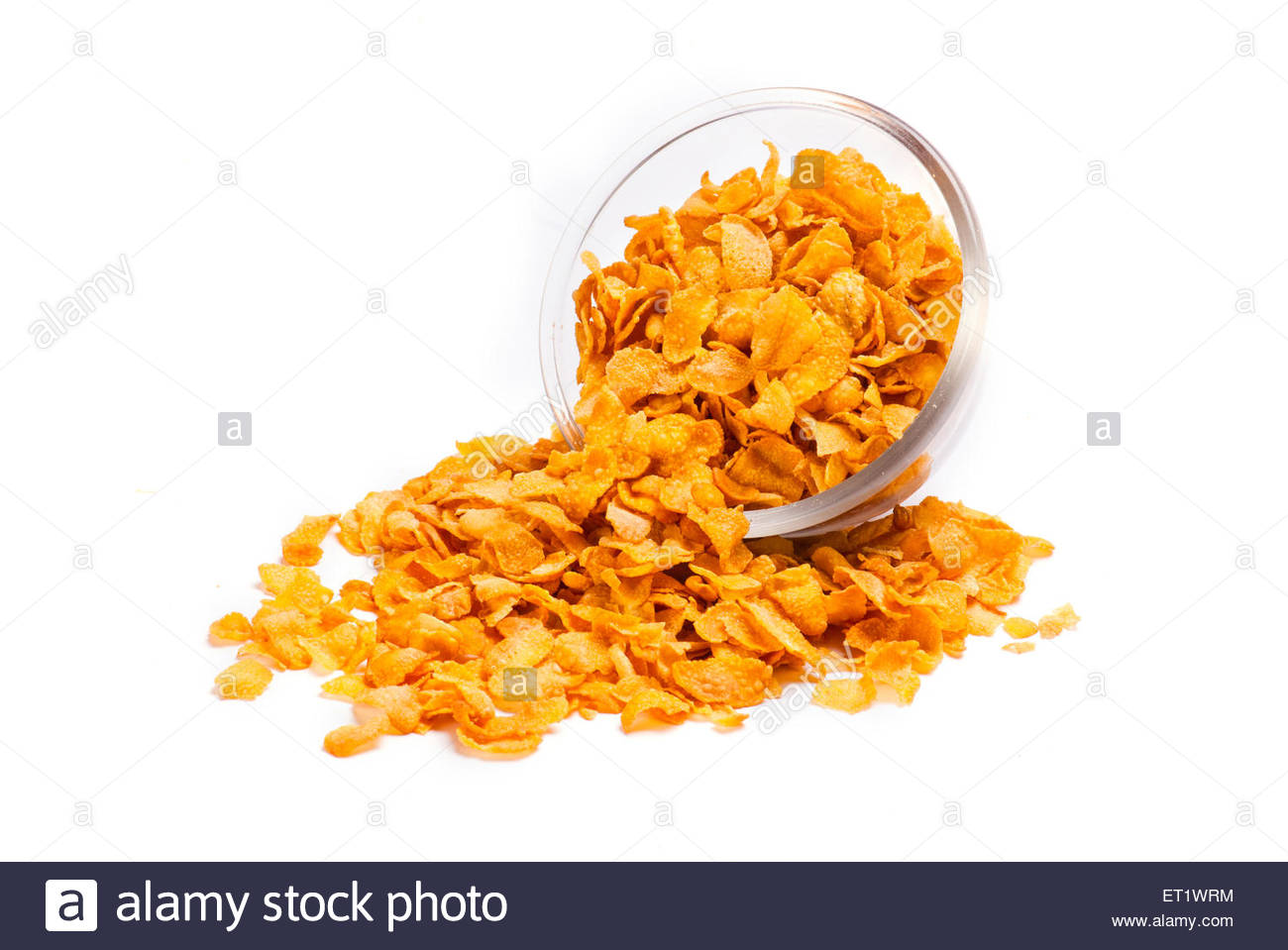 corn flakes in glass bowl on white isolated Background - Stock Image