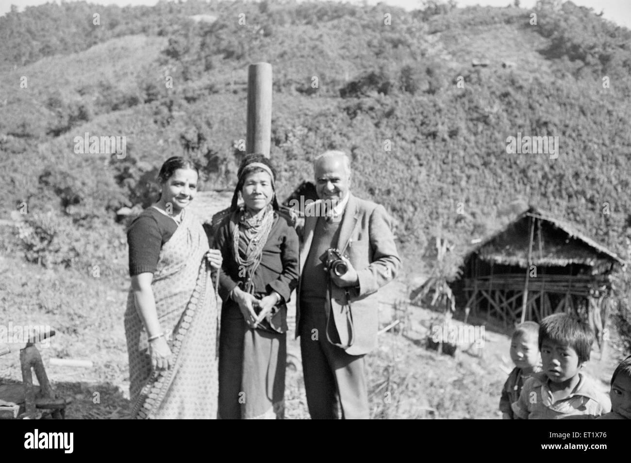 Mr and Mrs. TS. Satyan with Hill Miri tribal lady ; Arunachal Pradesh ; India NO MR - Stock Image