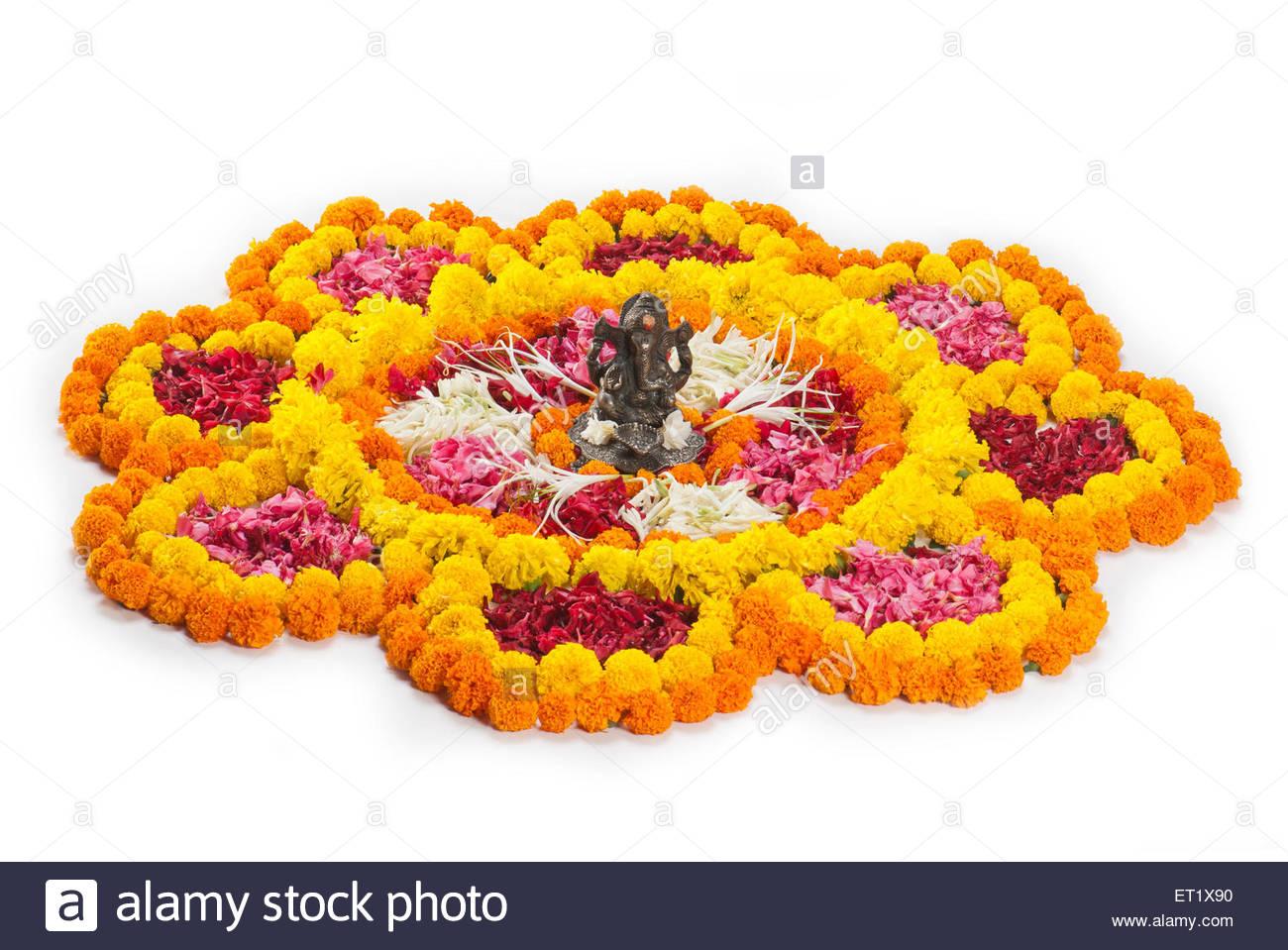 Lord Ganesha Idol On Flowers Rangoli Design On White Background In