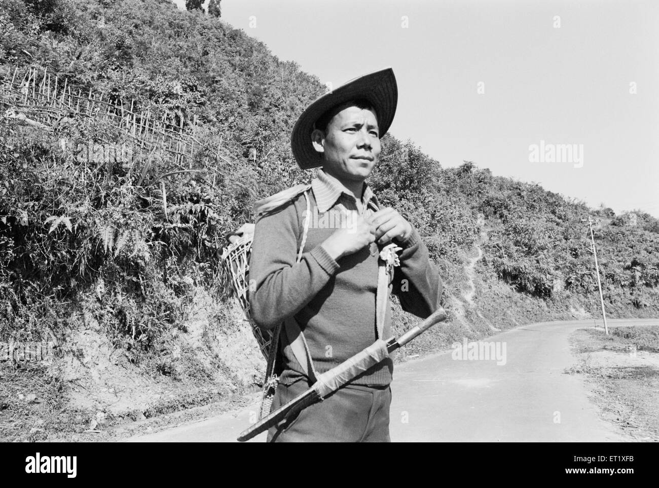 Hill Miri tribesman wearing bamboo hat ; Arunachal Pradesh ; India NO MR 1982 - Stock Image