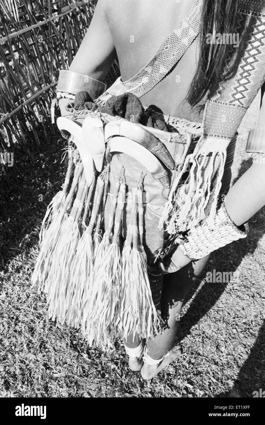 Shows adornment tied to waist of tribal  Apa Tani ; Arunachal Pradesh ; India 1982 - Stock Image
