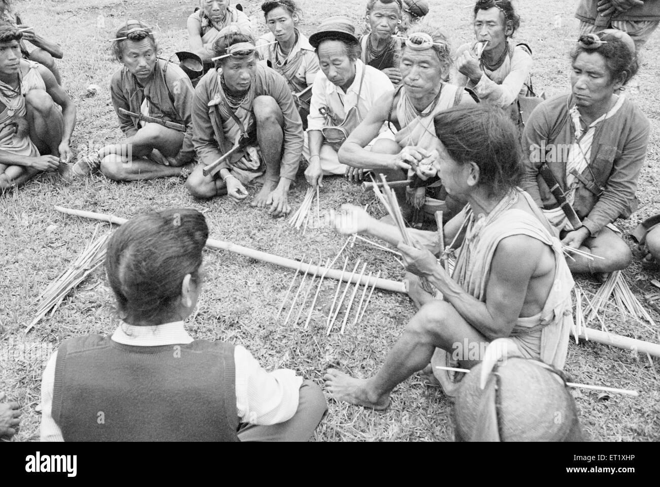 Bagni tribes men settling dispute between two group using small bamboo sticks ; Arunachal Pradesh ; India NO MR - Stock Image
