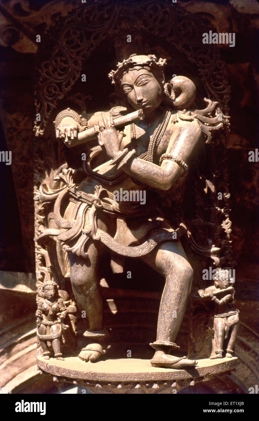 Lady playing flute sculpture in temple of chennakesava ; Belur ; Karnataka ; India - Stock Image