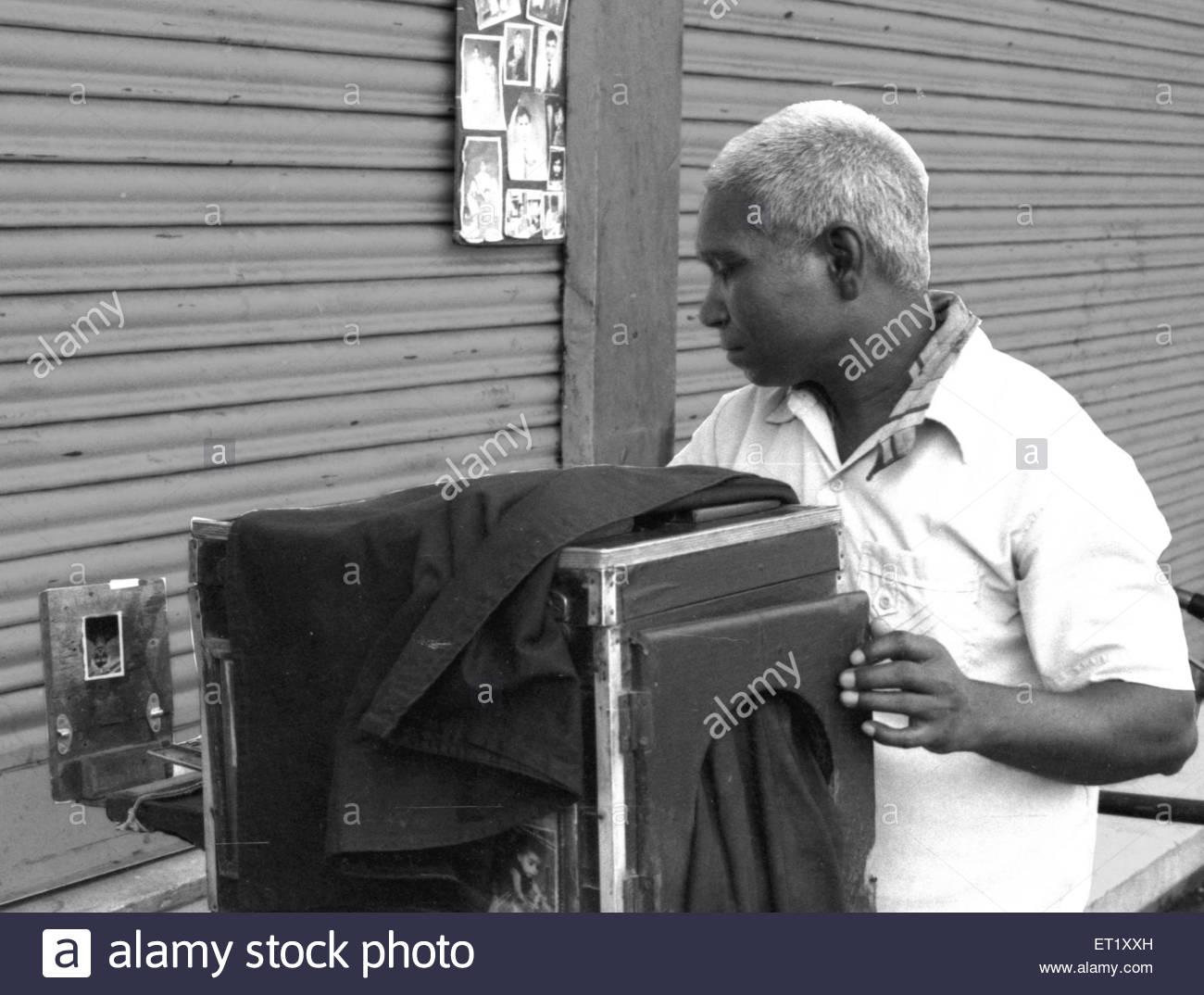 Vintage cameraman NO MR - Stock Image