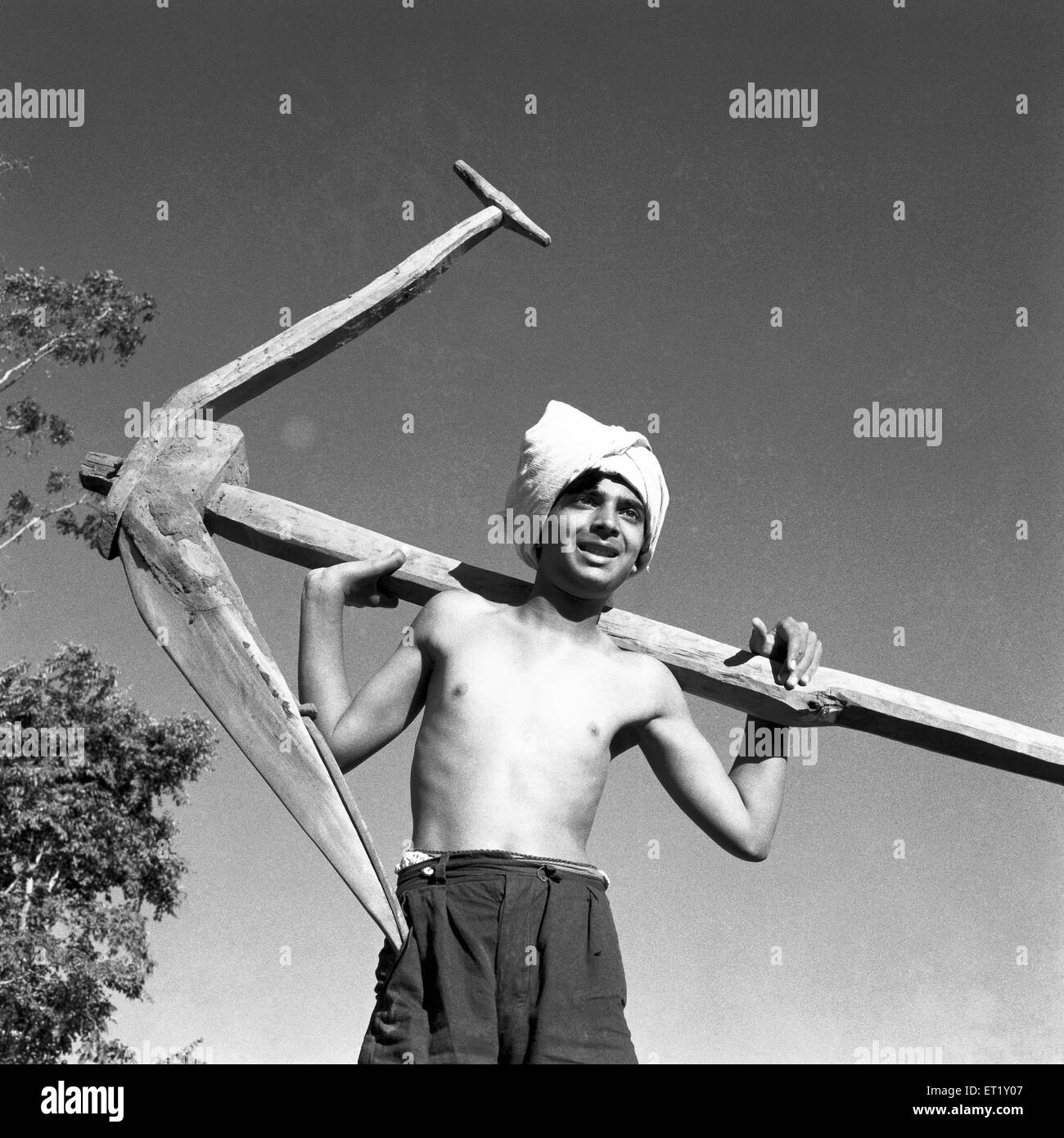 Peasant youth with a plough ; VIDYAPITH is training rural youth for progressive living ; Nanjangud town Mysore ; - Stock Image