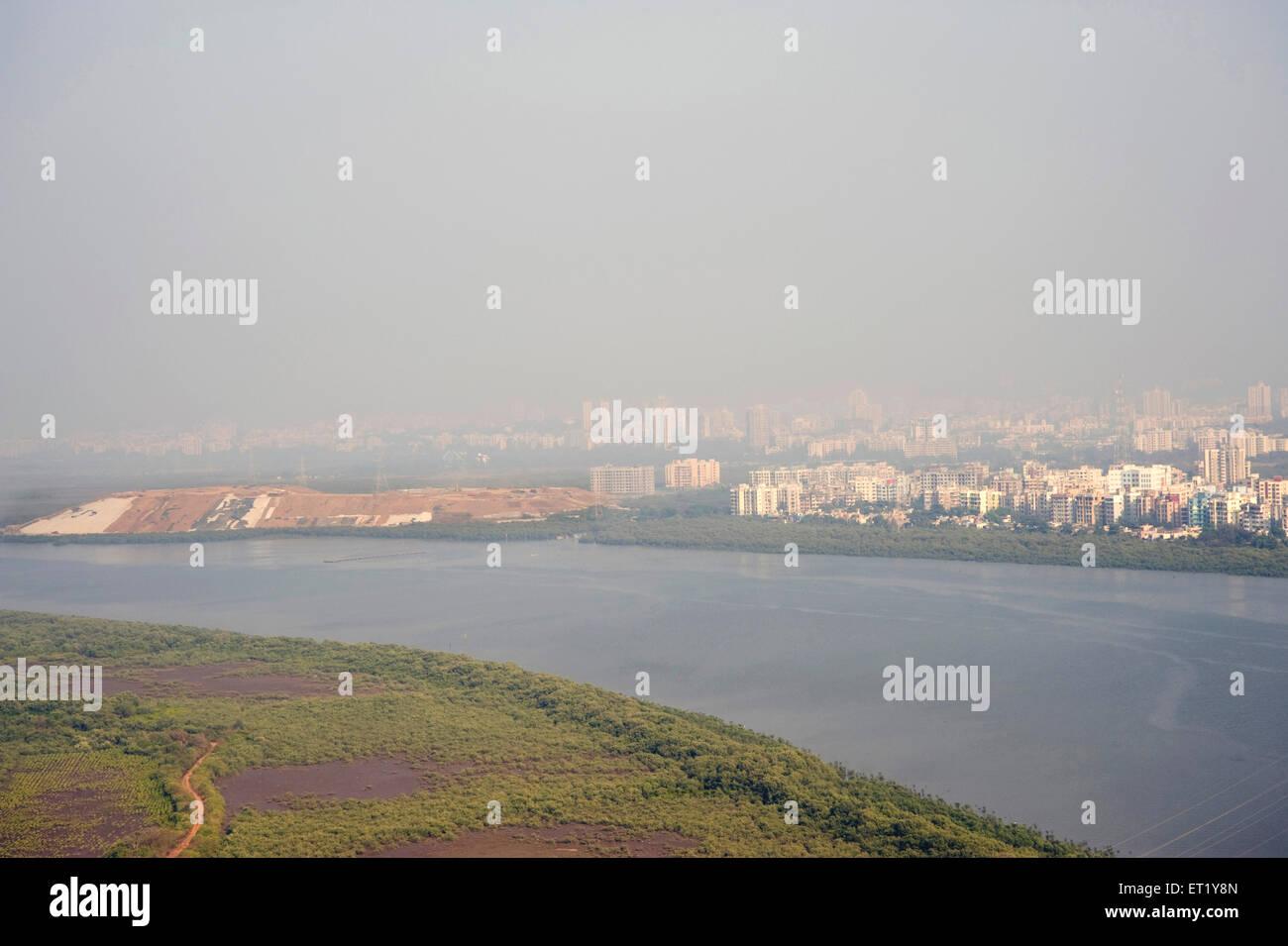 Landfill ; Gorai creek and mangroves trees ; Borivali ; Bombay Mumbai ; Maharashtra ; India - Stock Image