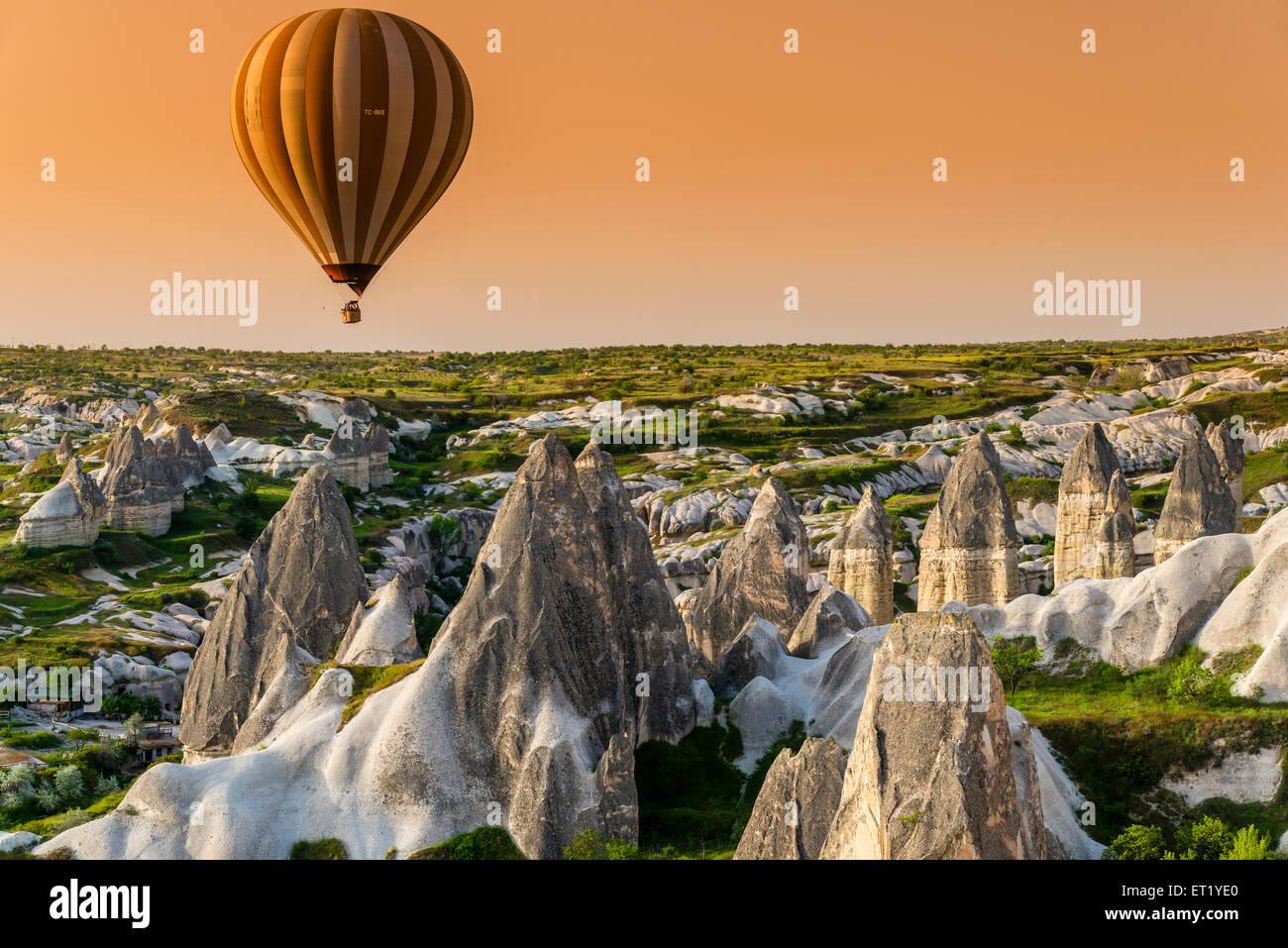 Sunrise landscape with hot air balloon, Goreme, Cappadocia, Turkey Stock Photo