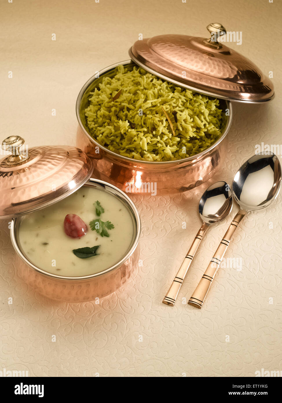 Food ; mung dal khichdi with kadhi served in pots - Stock Image