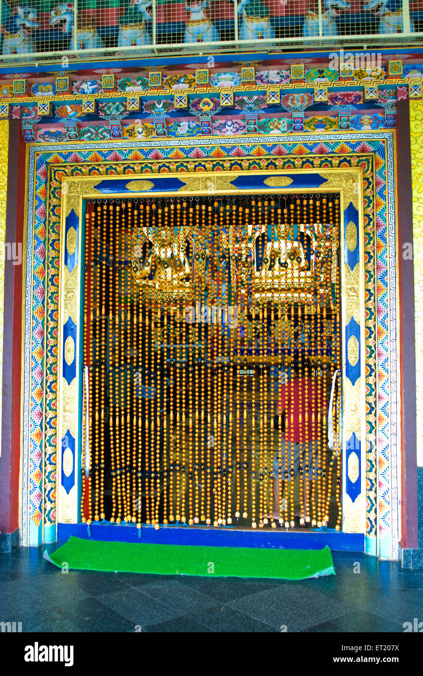 Curtain of beads at entrance to Namdroling monastery Palyul Nyingmapa Buddhist centre ; Byalakuppe ; Mysore ; Karnataka Stock Photo