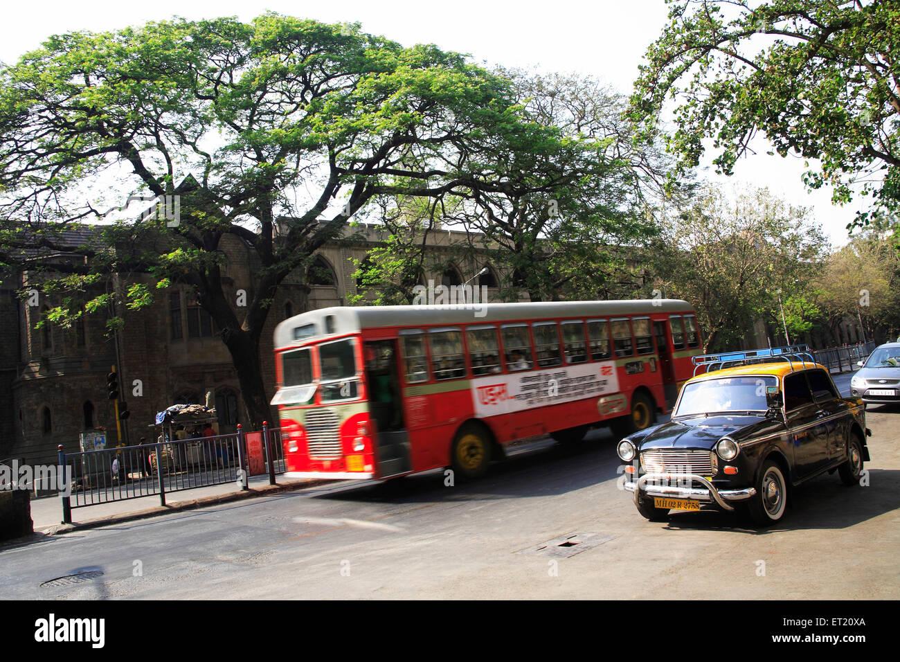 BEST bus and taxi ; Bombay Mumbai ; Maharashtra ; India - Stock Image