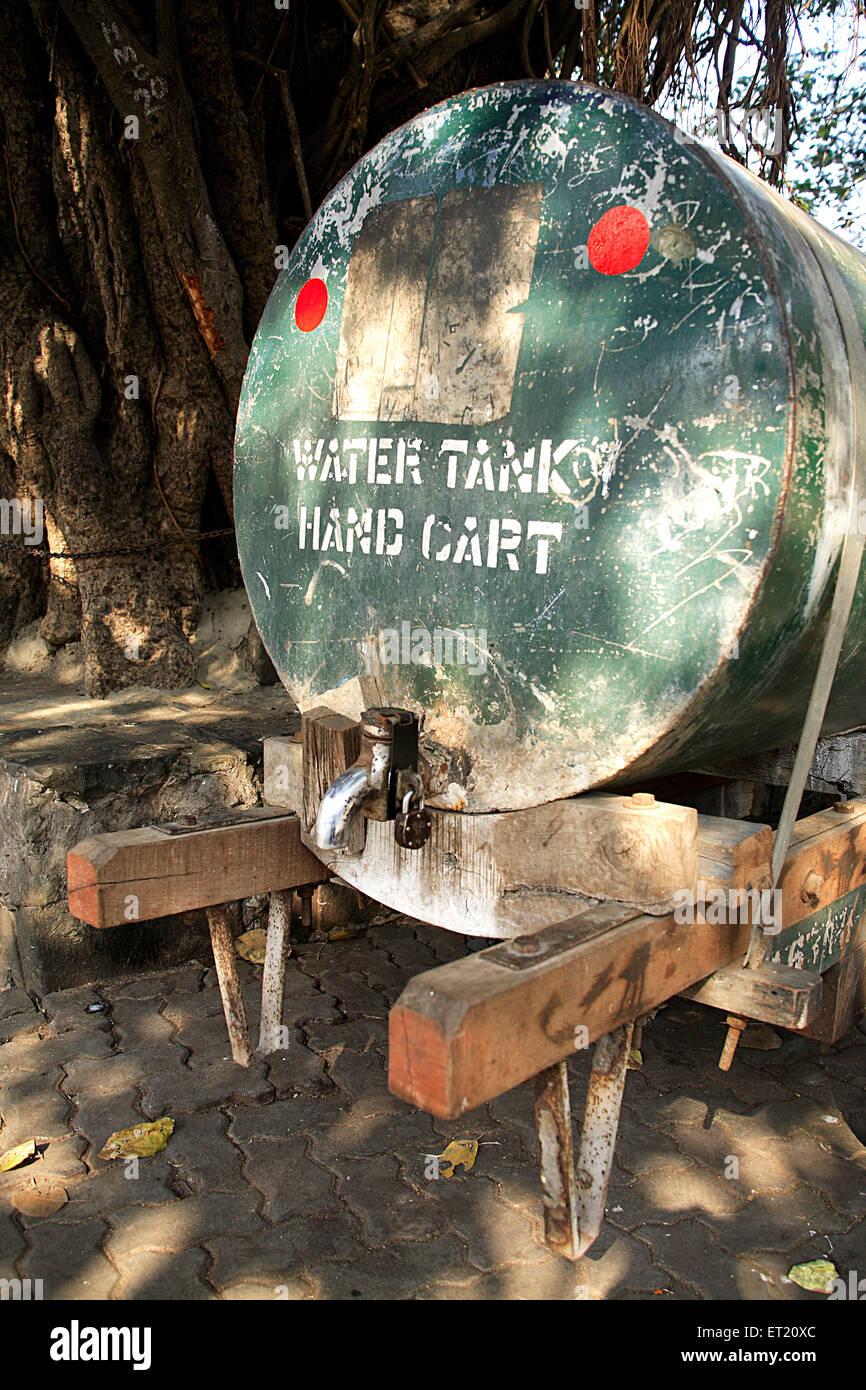 Handcart with water tank tap lock ; Bombay Mumbai ; Maharashtra ; India - Stock Image