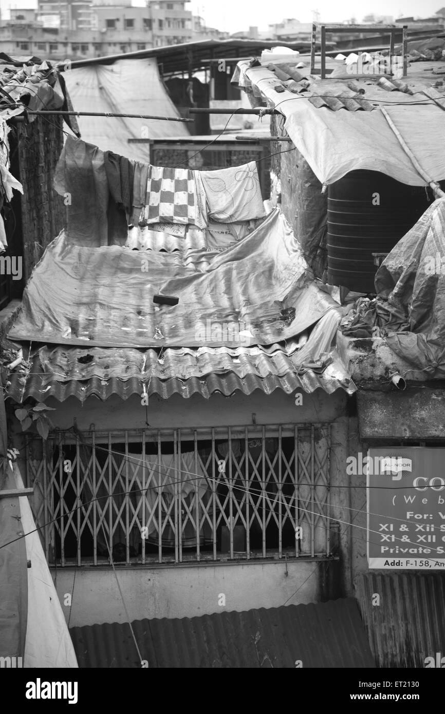 Slum Behram Naupada at Anant Kanekar Marg ; Bandra ; Bombay Mumbai ; Maharashtra ; India 9 September 2009 - Stock Image