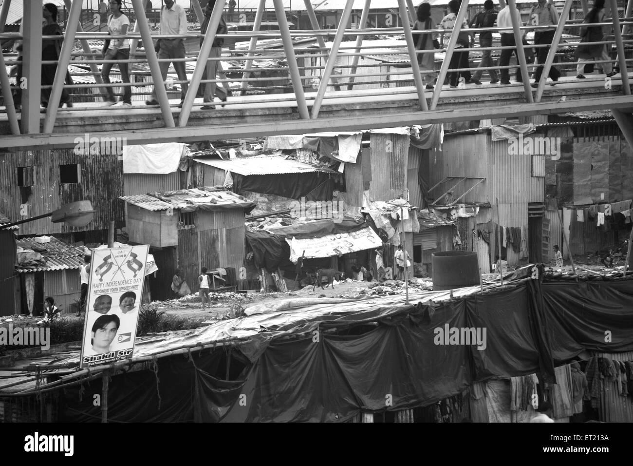Bridge over slum behram naupada  at Anant Kanekar Marg ; Bandra ; Bombay Mumbai ; Maharashtra ; India 9 September - Stock Image