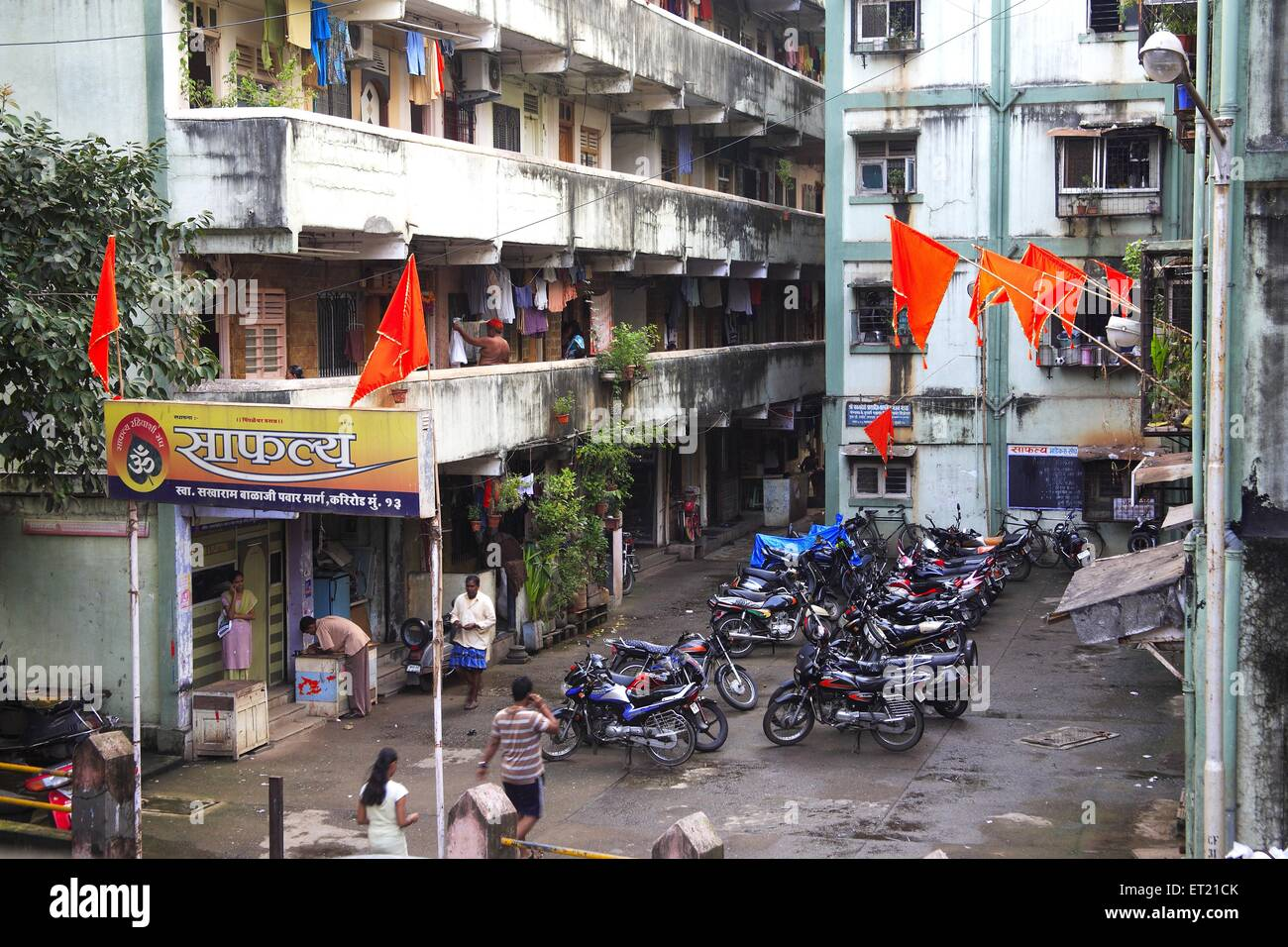 Flag and motorcycles parked in saphaly society ; Sakharam Balaji Pawar Marg ; Curry Road ; Bombay Mumbai - Stock Image