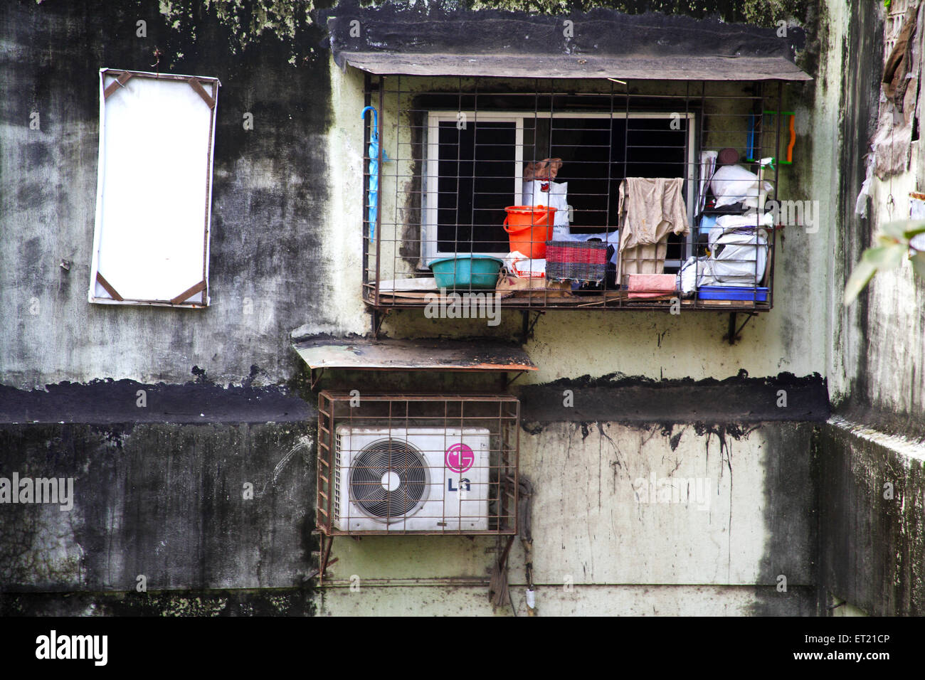 Window and air condition in saphaly society ; Sakharam Balaji Pawar Marg ; Curry Road ; Bombay Mumbai - Stock Image