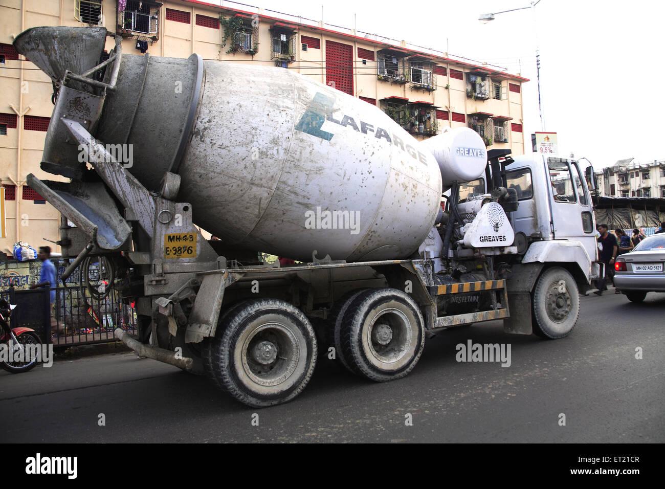 Concrete mixer on road ; Curry Road ; Bombay Mumbai ; Maharashtra ; India 26 August 2009 - Stock Image