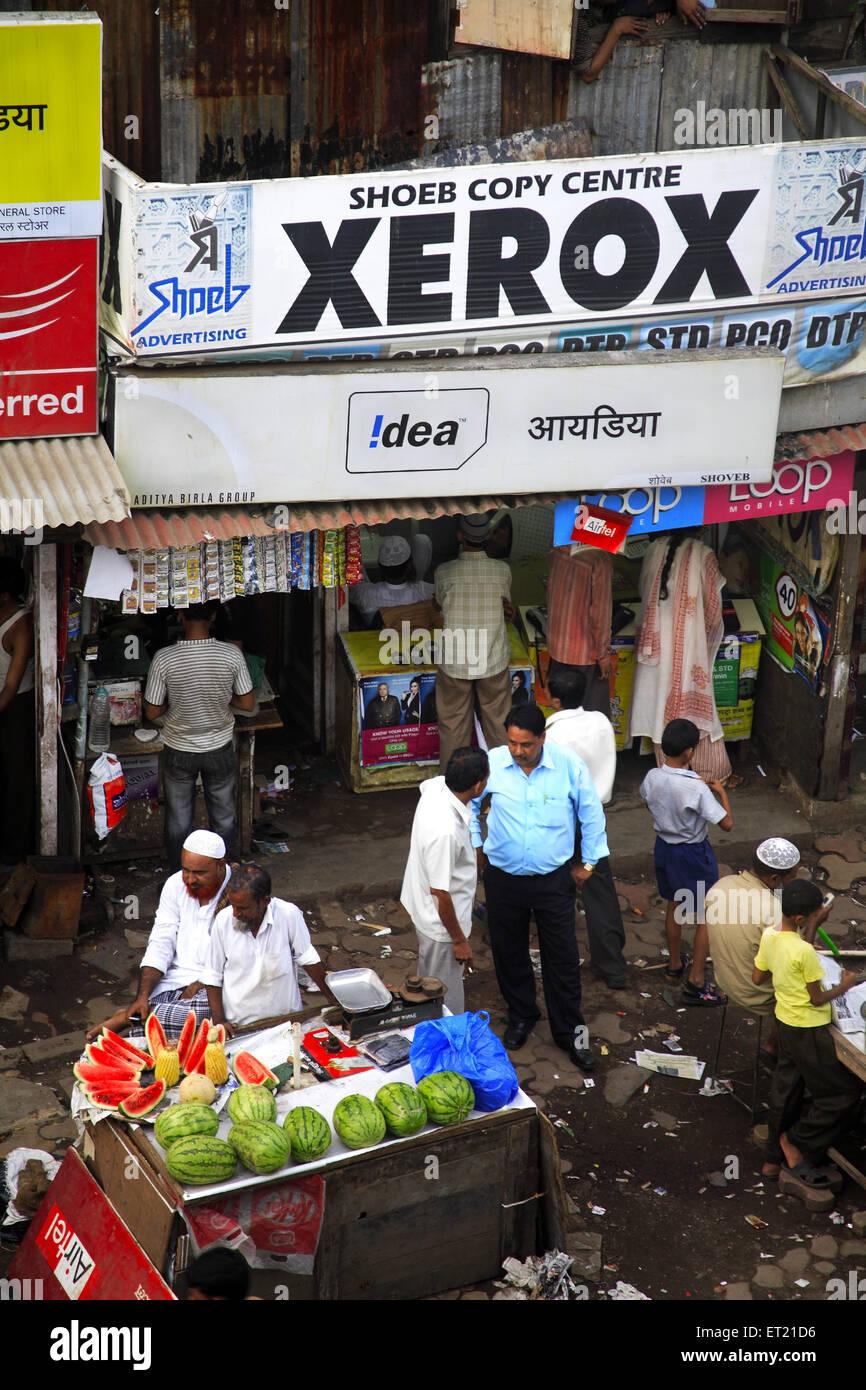 Xerox shop and watermelon vender ; Behram Naupada ; Anant Kanekar Marg ; Bandra ; Bombay Mumbai ; Maharashtra - Stock Image