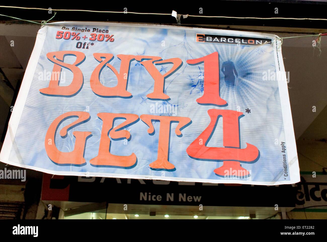 Buy one get four banner hanging outside store Part of Diwali celebration ; Gandhidham ; Kutch ; Gujarat ; India - Stock Image