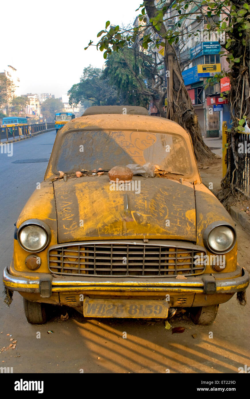 Old unused discarded covered with dust taxi Bhowanipur Calcutta Kolkata West Bengal India - Stock Image