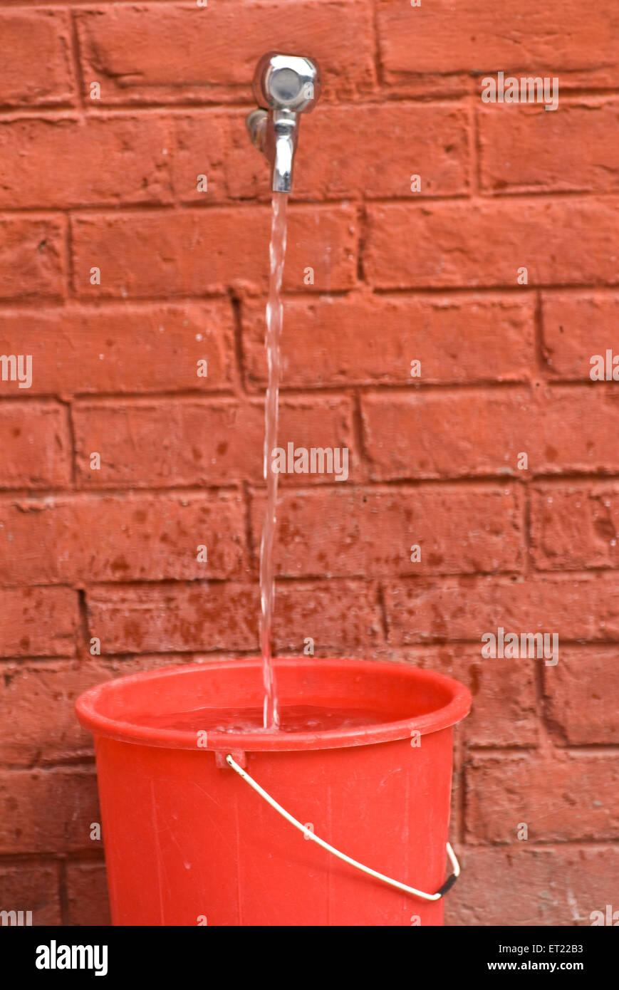 Tap water in bucket 2009 - Stock Image
