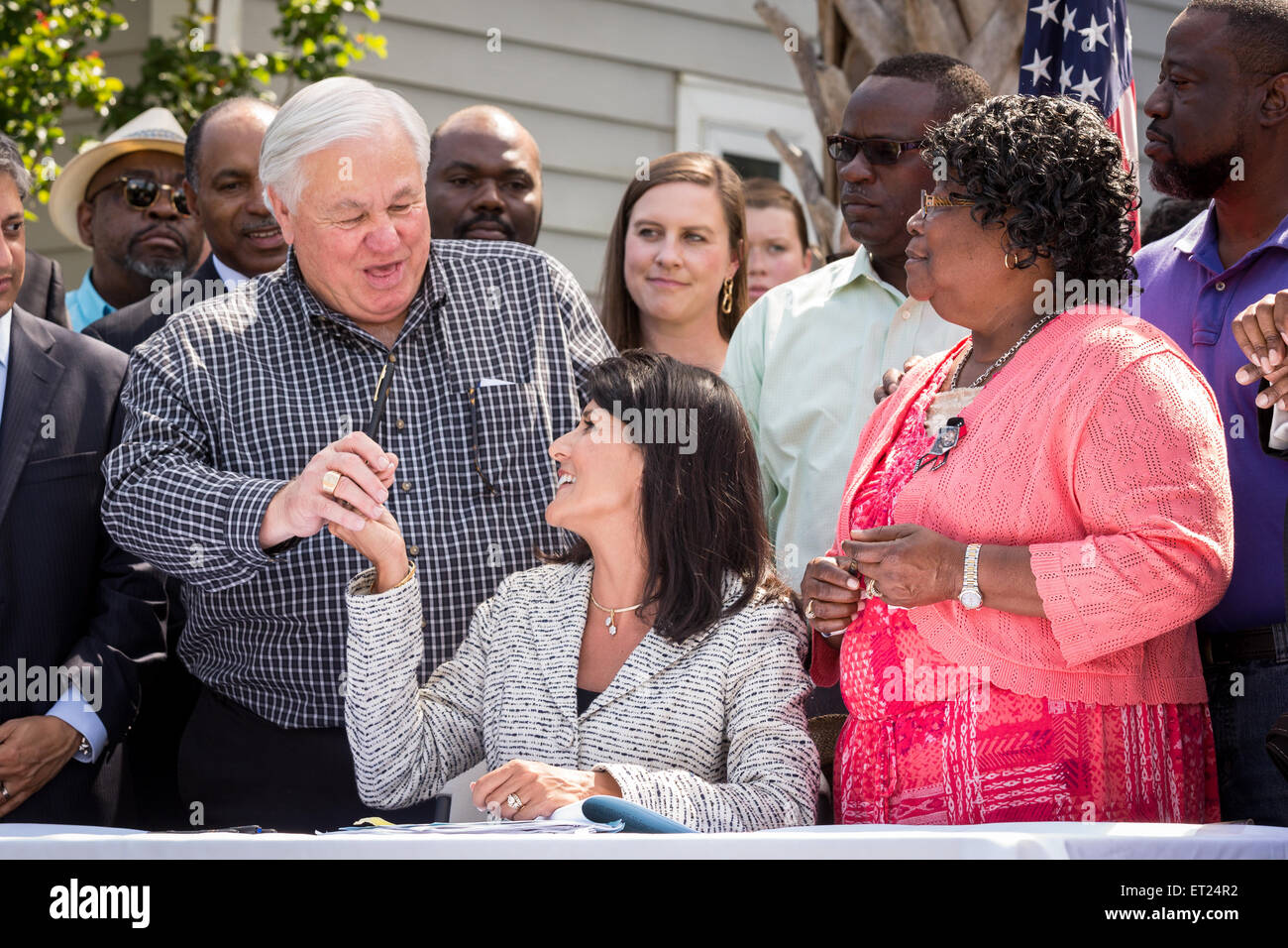 South Carolina Governor Nikki Haley gifts a signing pen to North Charleston Mayor Keith Summey after signing into law the first bill in the nation requiring ...