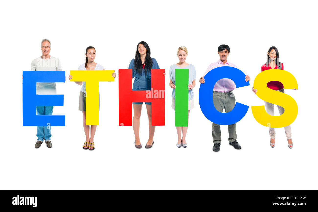 Group of Business people holding the letter 'ETHNICS' - Stock Image