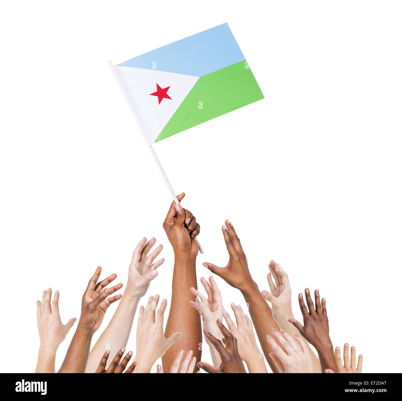 Group of multi-ethnic people reaching for and holding the flag of Djibouti. - Stock Image