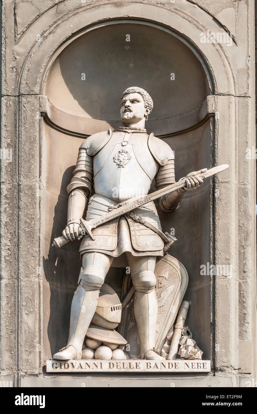 Statue of Giovanni dalle Bande Nere (Giovanni de Medici) in Uffizi gallery, seen in Lungarno degli Archibusieri Stock Photo