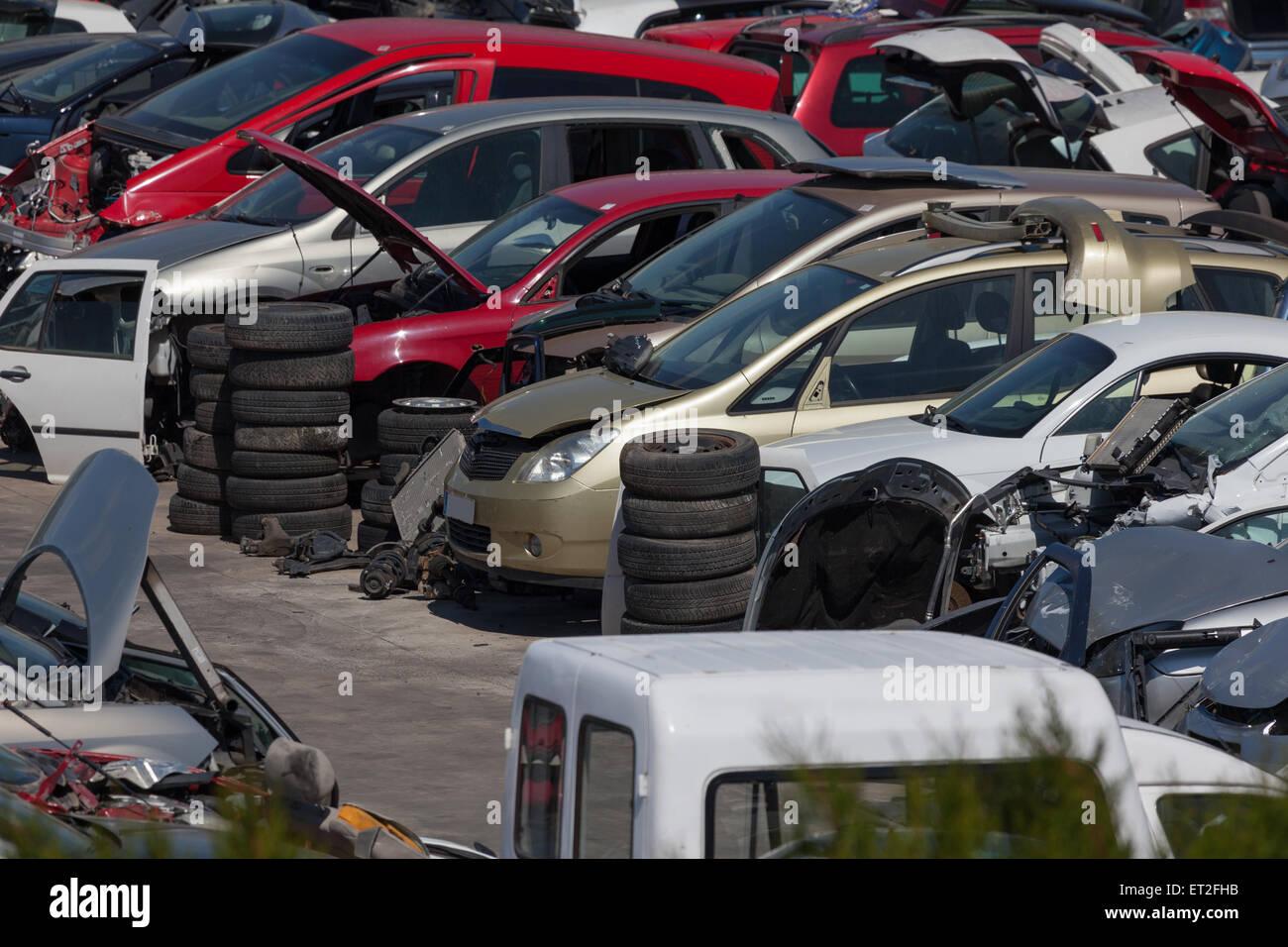 Old cars at the scrap yard - Stock Image